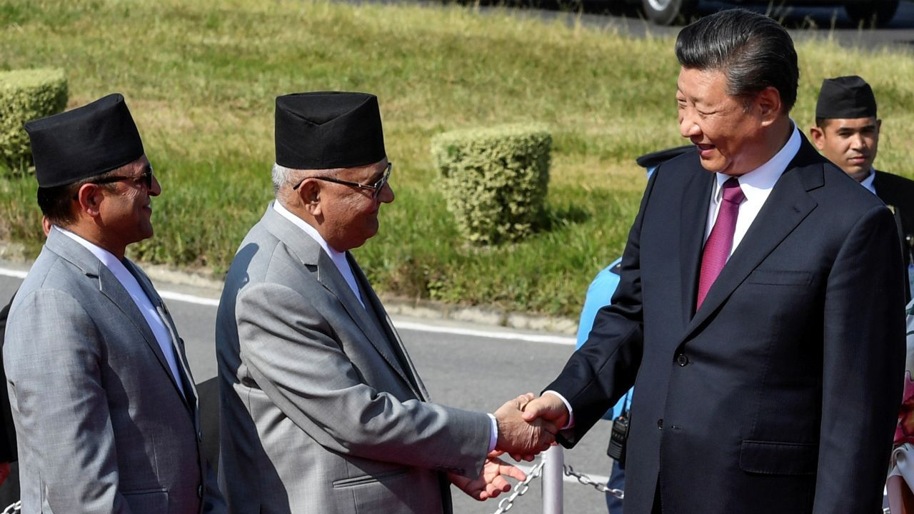 China's President Xi Jinping shakes hands with Nepal's Prime Minister KP Sharma Oli
