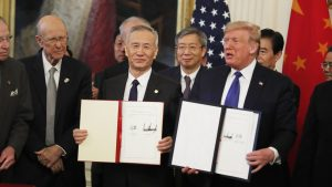 U.S. President Donald Trump and Chinese Vice Premier Liu He show the signed China-U.S. phase-one economic and trade agreement