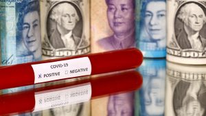 A test tube labelled with the coronavirus is seen in front of U.S. dollar, yuan and pound banknotes, in this illustration taken on March 1, 2020. REUTERS/Dado Ruvic (Bosnia and Herzegovina)