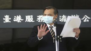 Taiwan's Mainland Affairs Council Minister Chen Ming-tong gestures while speaking during an opening ceremony of the Taiwan Hong Kong Service Exchange Office, in Taipei, Taiwan, Wednesday, July 1, 2020. Taiwan officially opened the specialized office on Wednesday to support Hong Kong people seeking to move to Taiwan after China's passage of a national security law for Hong Kong. (AP Photo/Chiang Ying-ying)