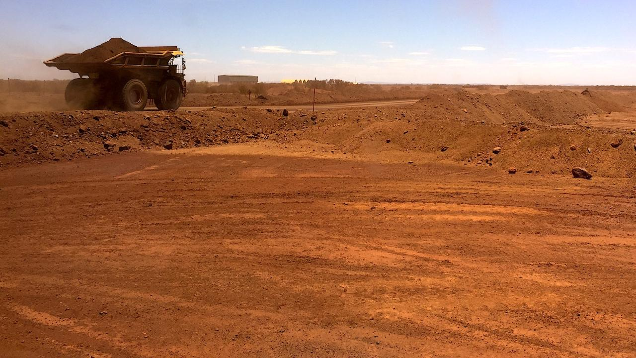 An autonomous vehicle drives along a road as it collects iron ore at Australia's Fortescue Metals Group (FMG) mine in the Pilbara region, located south-east of the coastal town of Port Hedland in Western Australia, November 29, 2018. Picture taken November 29, 2018. REUTERS/Melanie Burton (Australia)