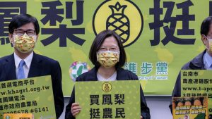 March 3, 2021, Taipei, Taiwan: Tsai Ing-Wen (C), Taiwanese President and chairwoman of the DPP, seen holding a placard during a press conference at the Democratic Progressive Party (DPP) office..In response to China's ban on exports of Taiwan-grown pineapples, the Taiwan government is promoting local products based on home grown pineapples. (Credit Image: © Walid Berrazeg/SOPA Images via ZUMA Wire)