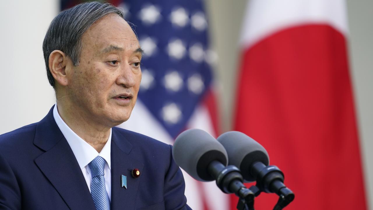 日米首脳会談における菅総理の苦し気な表情(写真:AP/アフロ)