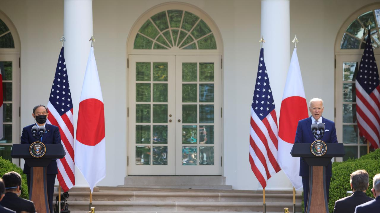 Japan's Prime Minister Yoshihide Suga and U.S. President Joe Biden hold a joint news conference in the Rose Garden at the White House in Washington, U.S., April 16, 2021. REUTERS/Tom Brenner (United States)