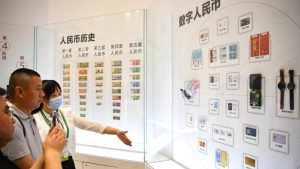 Visitors learn about digital Chinese yuan (e-CNY) at the first China International Consumer Products Expo in Haikou, capital of south China's Hainan Province, May 8, 2021. Several banks have offered experience zones for payment with e-CNY at the Expo. (Xinhua/Guo Cheng)