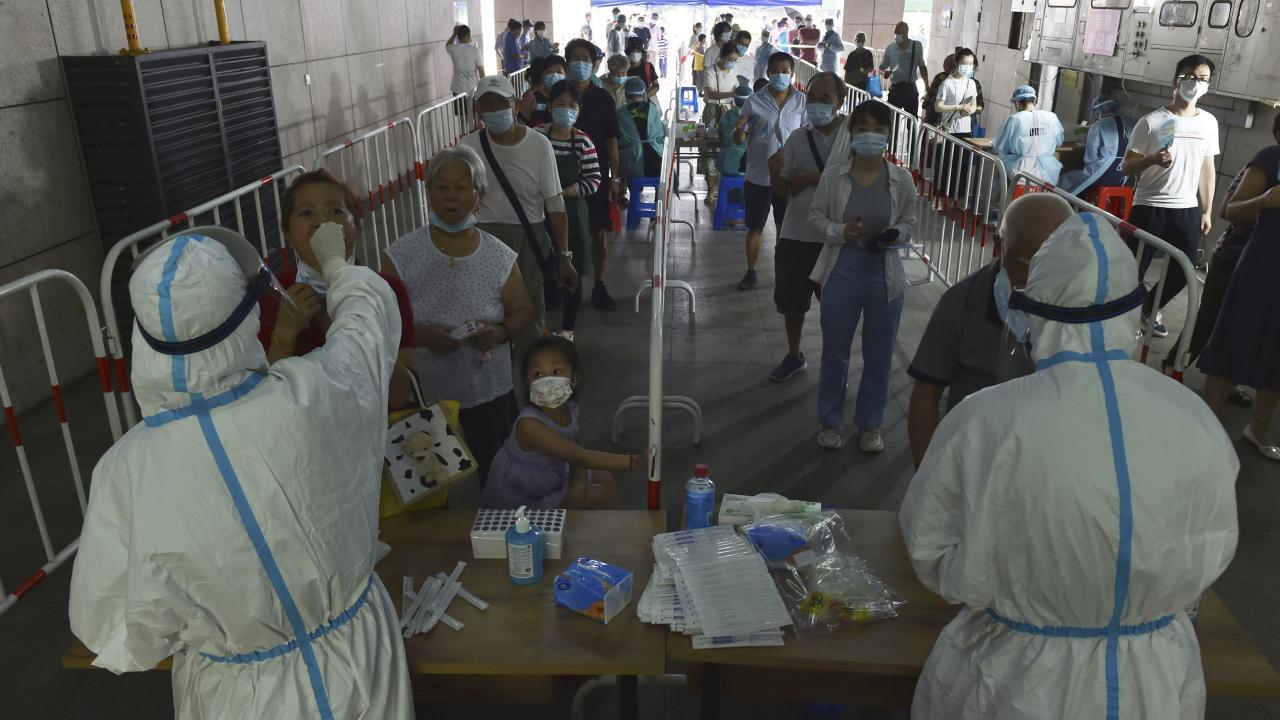 新型コロナ感染症 中国、感染拡大を警戒(写真:AP/アフロ)