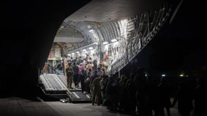 Afghans board a U.S. Air Force C-17 Globemaster III transport plane during an evacuation at Hamid Karzai International Airport, Afghanistan, August 22, 2021. Picture taken August 22, 2021. U.S. Air Force/Handout via REUTERS. THIS IMAGE HAS BEEN SUPPLIED BY A THIRD PARTY. (Photo provided by U.S. Air Force/REUTERS/aflo)