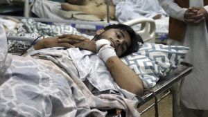 Afghans lie on beds at a hospital after they were wounded in the deadly attacks outside the airport in Kabul, Afghanistan, Thursday, Aug. 26, 2021. Two suicide bombers and gunmen attacked crowds of Afghans flocking to Kabul's airport Thursday, transforming a scene of desperation into one of horror in the waning days of an airlift for those fleeing the Taliban takeover. (AP Photo/Khwaja Tawfiq Sediqi)