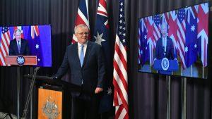 Britain's Prime Minister Boris Johnson, Australia's Prime Minister Scott Morrison and US President Joe Biden at a joint press conference via AVL from The Blue Room at Parliament House in Canberra, Thursday, September 16, 2021. (AAP Image/Mick Tsikas)